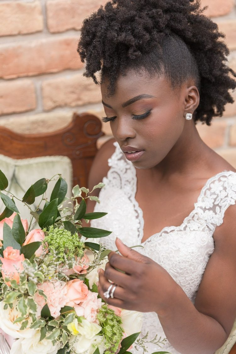 The bride was wearing a faux mohawk and a neutral makeup for a romantic yet modern feel