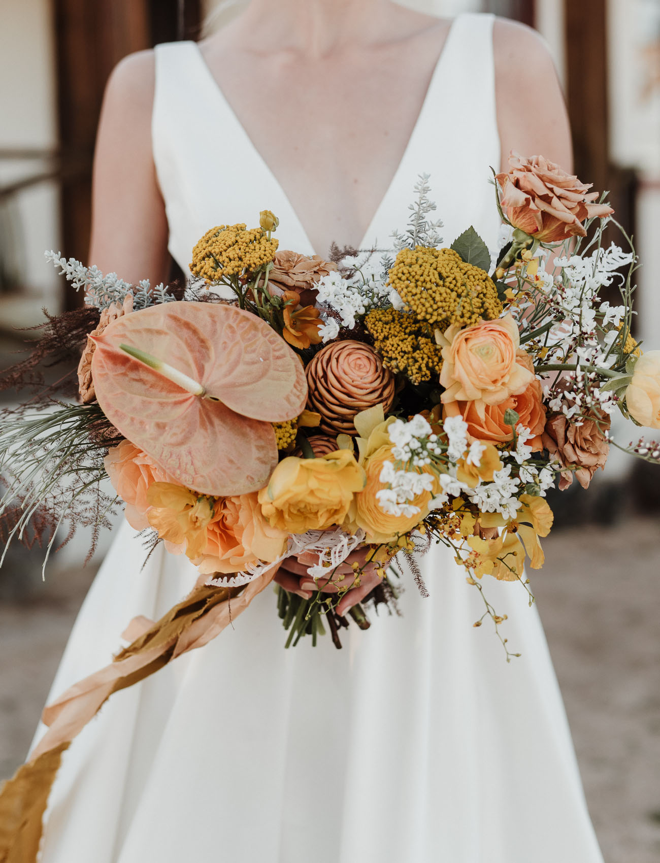 The fantastic wedding bouquet was done in rust, mustard and yellow shades and with pale greenery and herbs