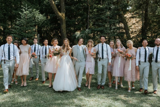 The groom was rocking a light grey three-piece suit and a shirt, and the groomsmen were wearing white shirt, grey pants, black ties and suspenders