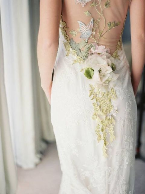 a lace sheath wedding dress with colorful lace appliques and fabric flowers will make you look like a forest nymph