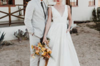 05 The bride's lips were red and she was rocking a wavy updo, the groom was wearing a dove grey suit with a printed tie and brown shoes