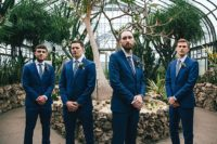 05 The groom and groomsmen were rockign bright blue suits, blue ties and a florla one for the groom