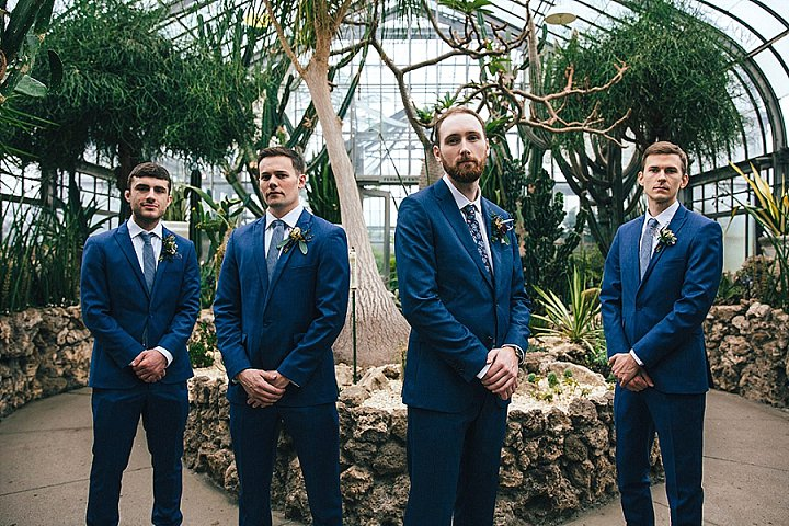 The groom and groomsmen were rockign bright blue suits, blue ties and a florla one for the groom