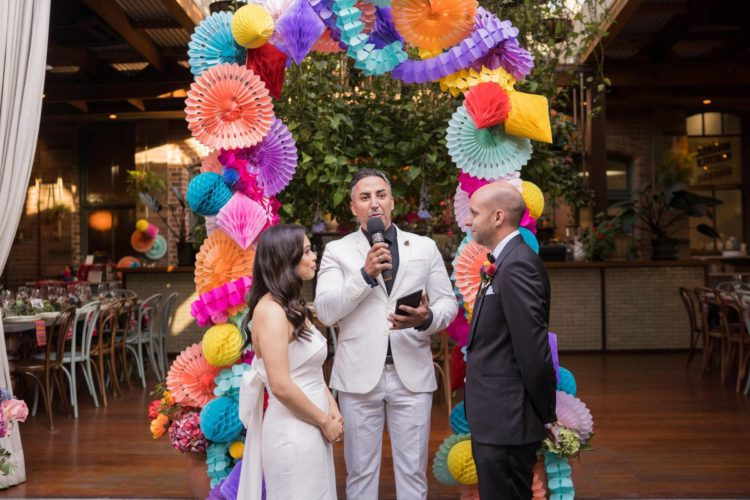 The wedding arch was done of colorful paper balls and fans for more color