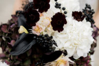 05 The wedding bouquet was done with black callas, berries, dark hydrangeas and white and blush blooms