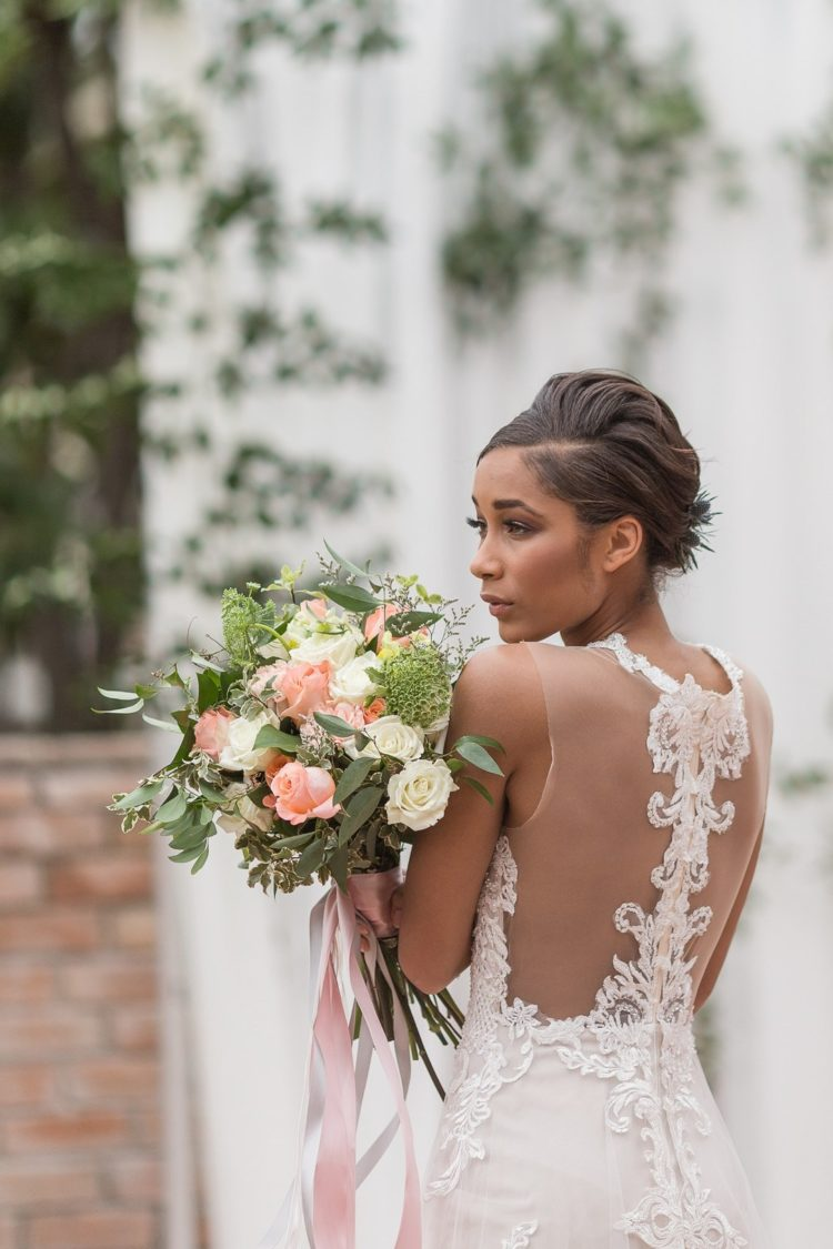 The back of the dress was illusion embellished, and her hairstyle was a sleek updo