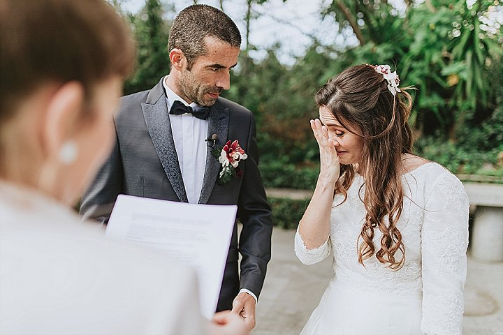 The bride was rocking a wavy half updo with blooms