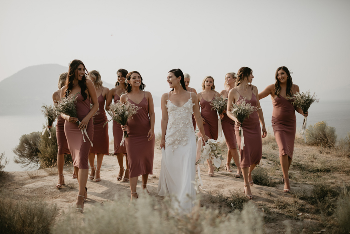The bridesmaids were rocking rust-colored slip dresses and neutral bouquets with dried herbs