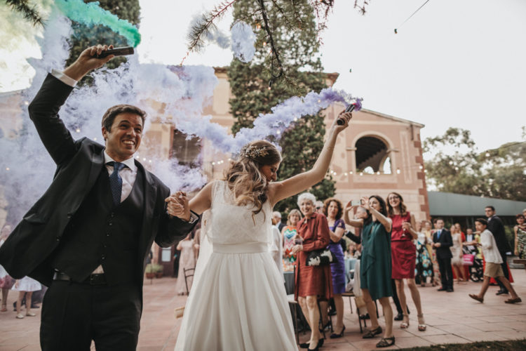 The couple had colorful smoke bombs for their portraits for a fun touch