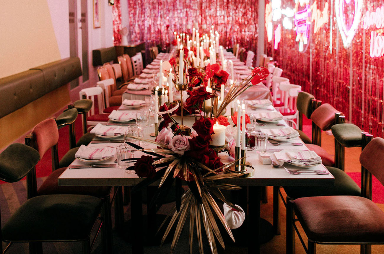 The reception space was done with neon lights, bright statement florals and rock n roll aesthetics