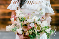06 The wedding bouquet was done with white, blush and dusty pink blooms and greenery