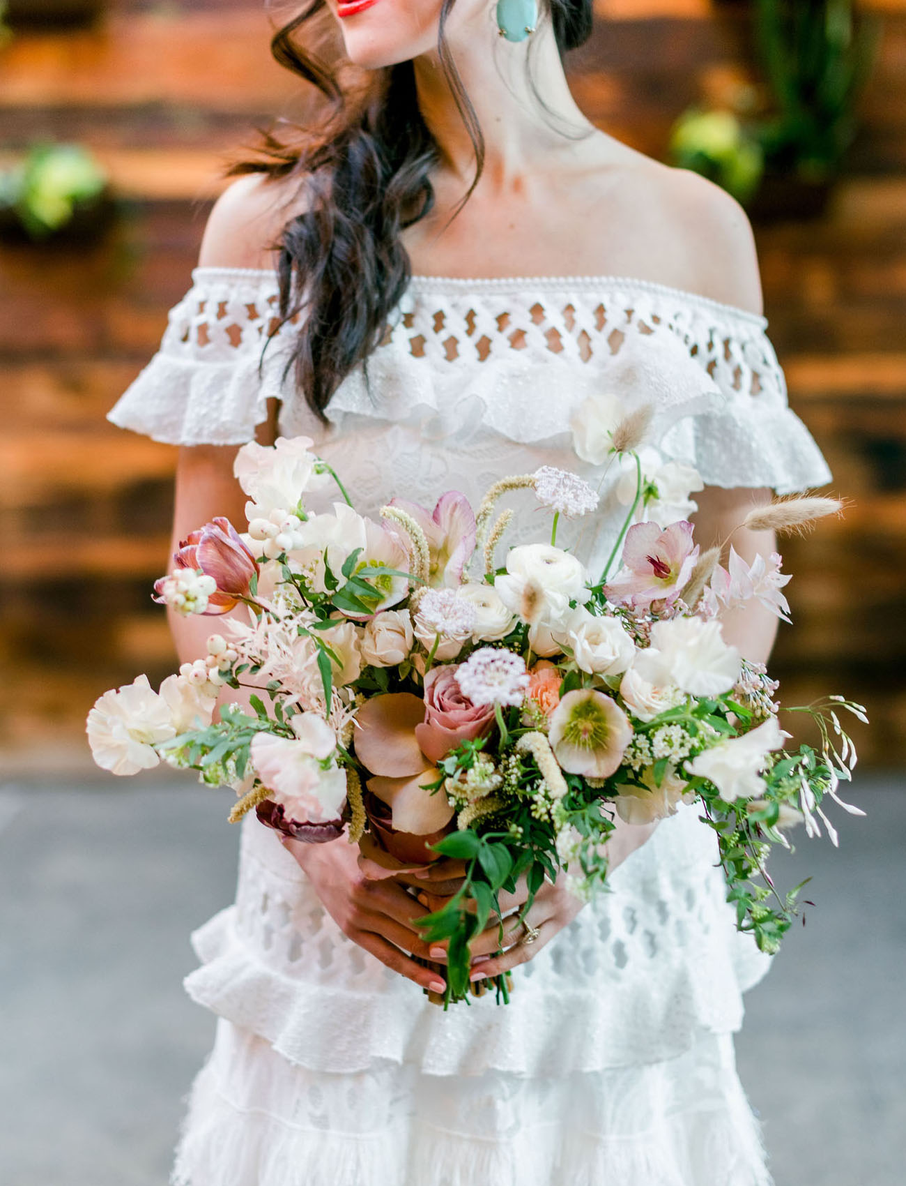 The wedding bouquet was done with white, blush and dusty pink blooms and greenery