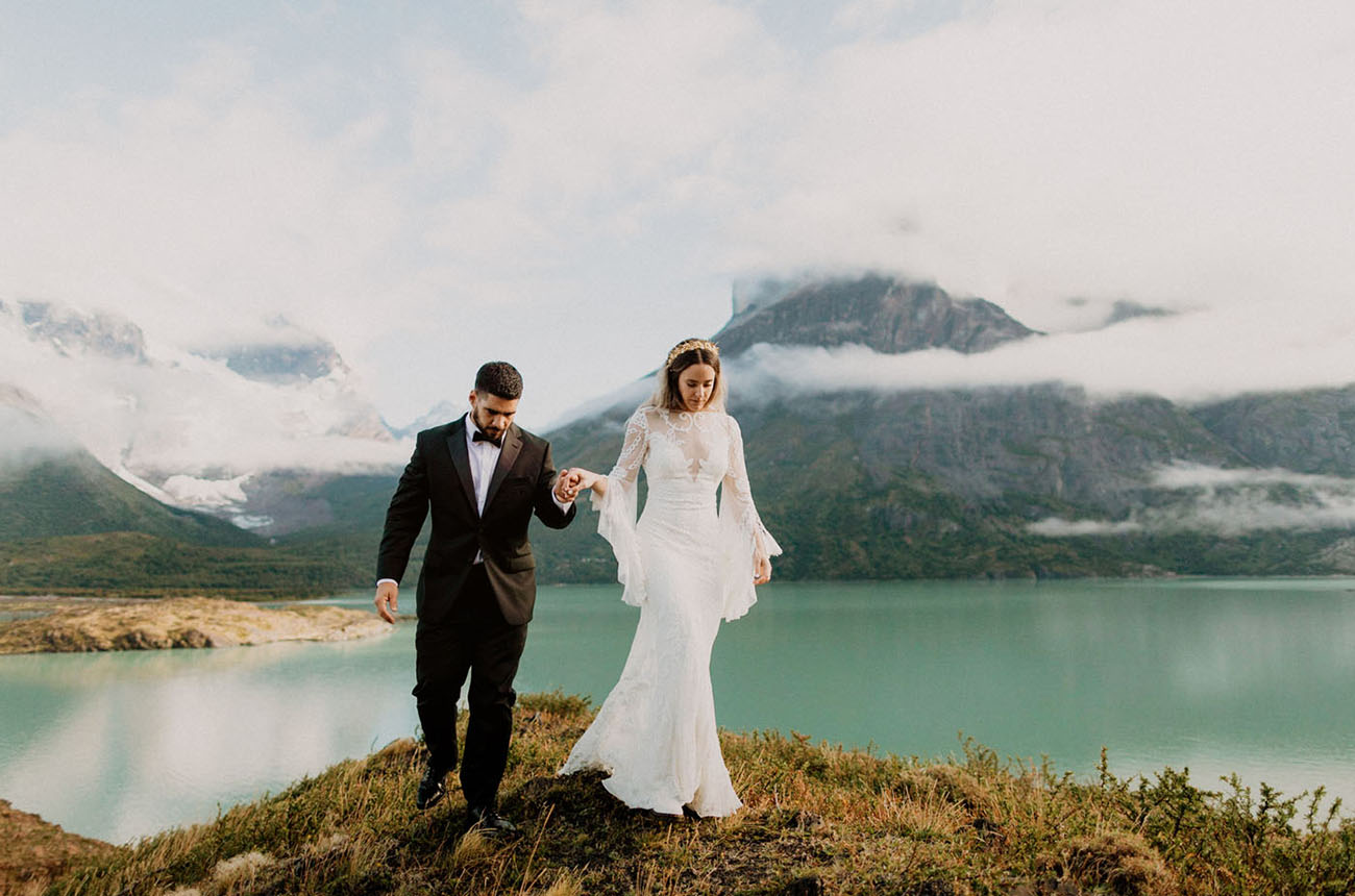 A beautiful lake, mpuntains and clouds over them added chic to the nuptials