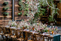 07 The reception space was done with lush white and pink blooms and greenery all over