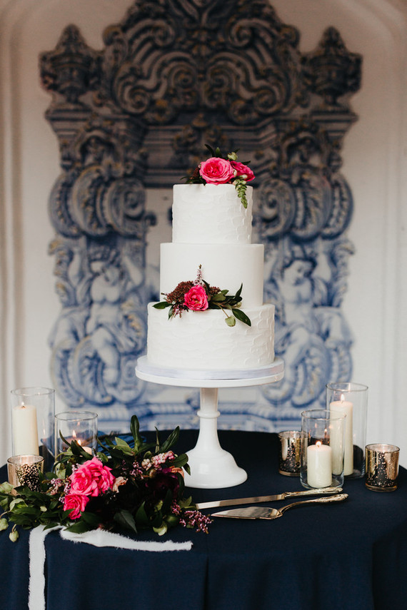 The wedding cake was white, sleek and texural, with bougainvilleas