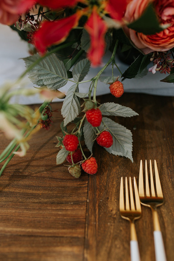 Fresh berries were added to the floral arrangements