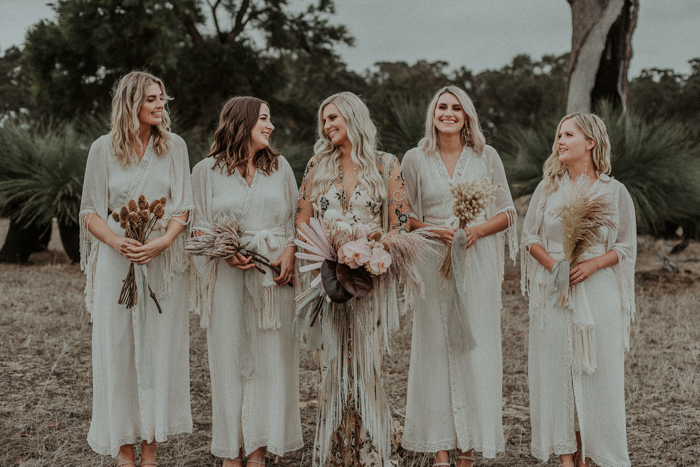 The bridesmaids were wearing neutral boho lace wrap dresses with bell sleeves and sashes