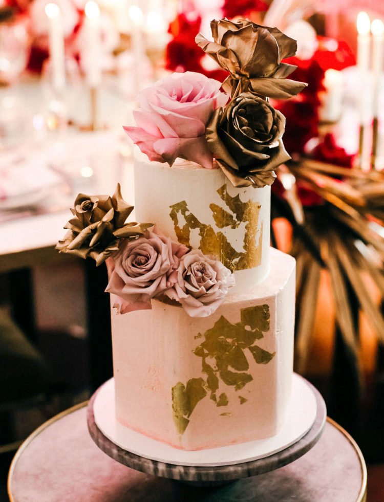 The wedding cake was a geometric one, with gold leaf, gold and pink roses