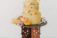 yellow wedding cake with cool details