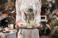 08 The wedding cake was totally boho, with watercolors and a folksy pattern plus a feather