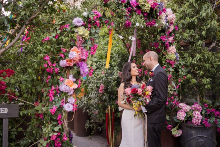 The wedding gate was done with super bright florals and ribbons