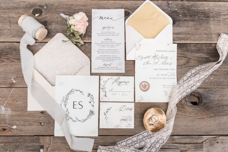 The wedding invitation suite was done in black and white, with gold lining and pretty seals
