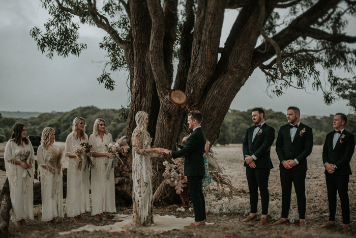 A living tree decorated with herbs and blooms was a wedding altar