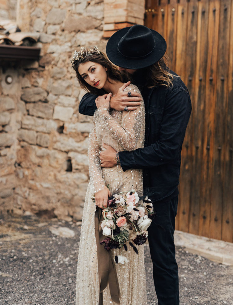 The groom was wearing a total black look with a hat, and the bride rocked a gorgeous embellished crown