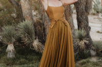 09 The second wedding dress was done in mustard, with a sleek bodice with spaghetti straps and a pleated skirt