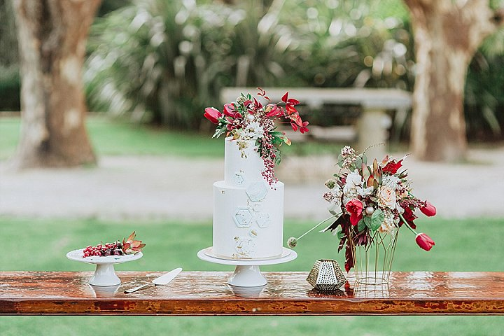 The wedding cake was decorated with geometric decor, bright blooms and leaves