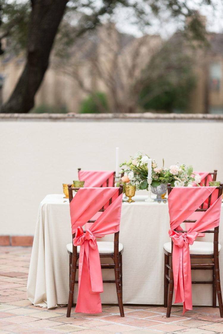 The wedding chairs were decorated with coral pink fabric that matched the napkins