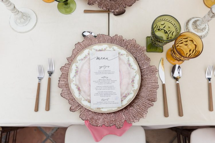 The place settings were done with beautiful rose gold chargers, floral plates, colored glasses, wooden cutlery