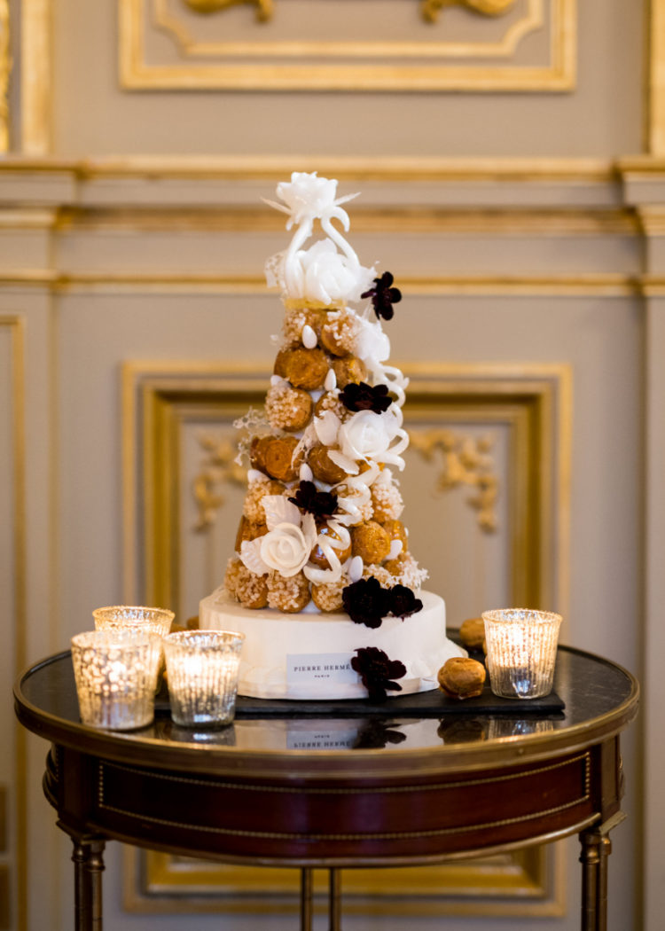 A wedding cake was substituted with a croquembouche to embrace the location