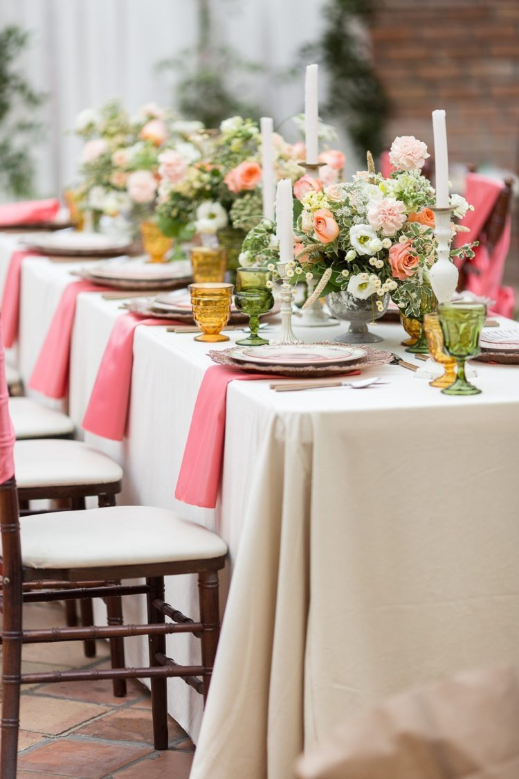 The florals were tender - blush, coral pink and white blooms and some greenery, candles added chic to the setting