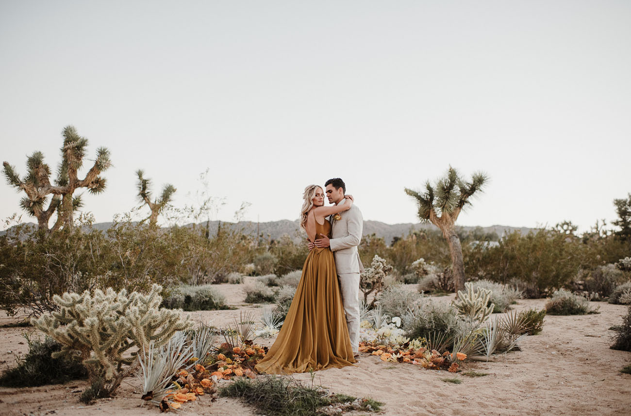 An alternative wedding altar was done with pale foliage, mustard and rust blooms placed on the sand