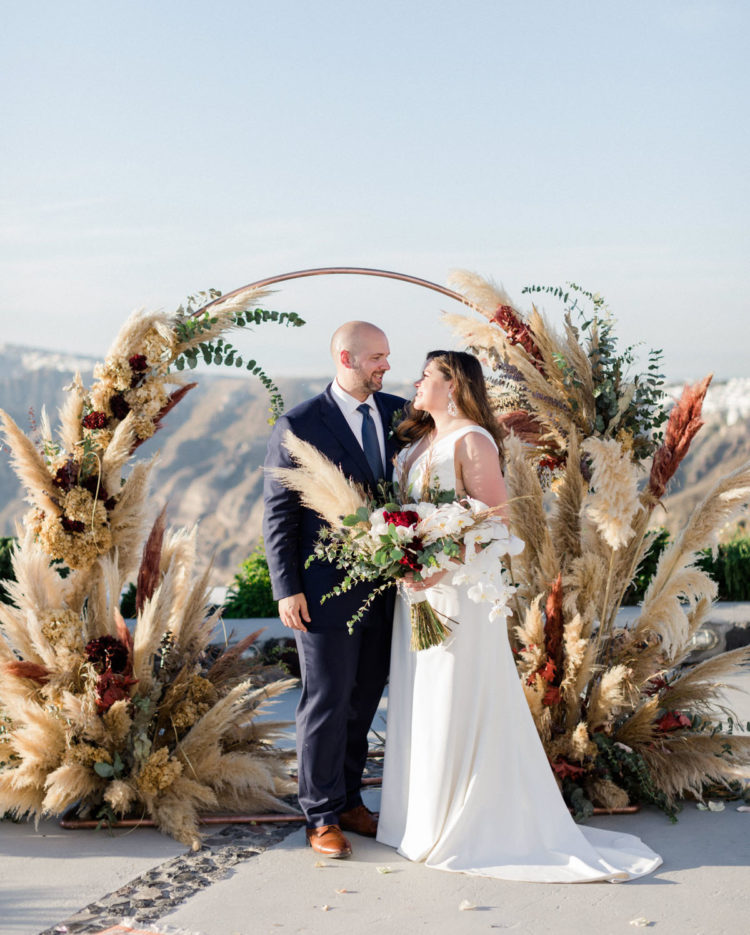 This beautiful Santorini wedding was filled with pampas grass, greenery and elegance