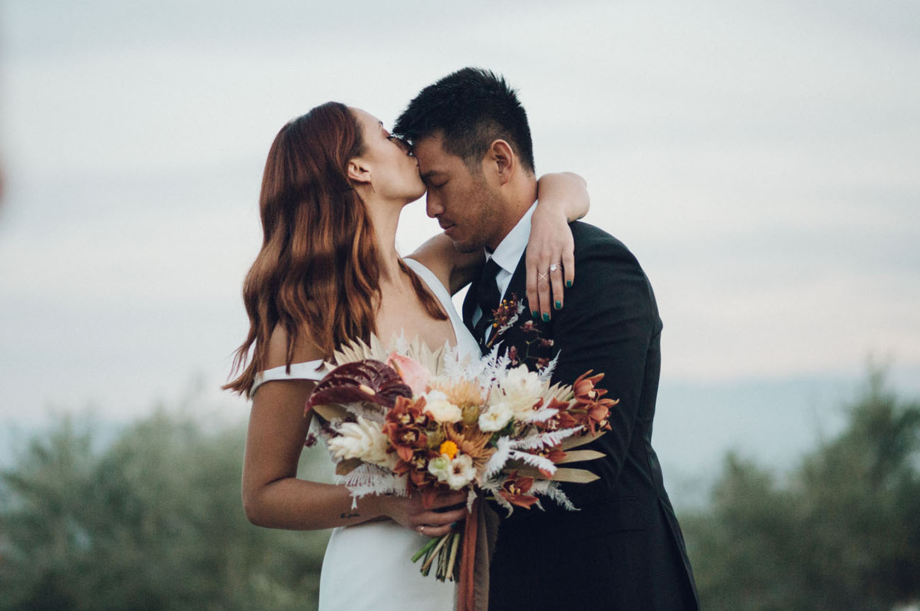 This couple went for a retro modern wedding in Palm Springs, it was done with tropical touches and muted tones