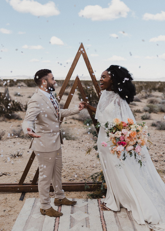 This wedding shoot took place in Joshua Tree and was done with a rust orange color palette, which is so trendy now