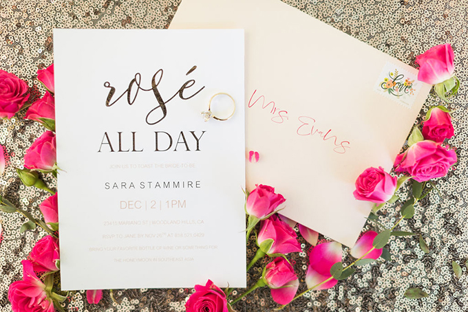 The bridal shower stationary was done in metallics, pink and black, with elegant lettering
