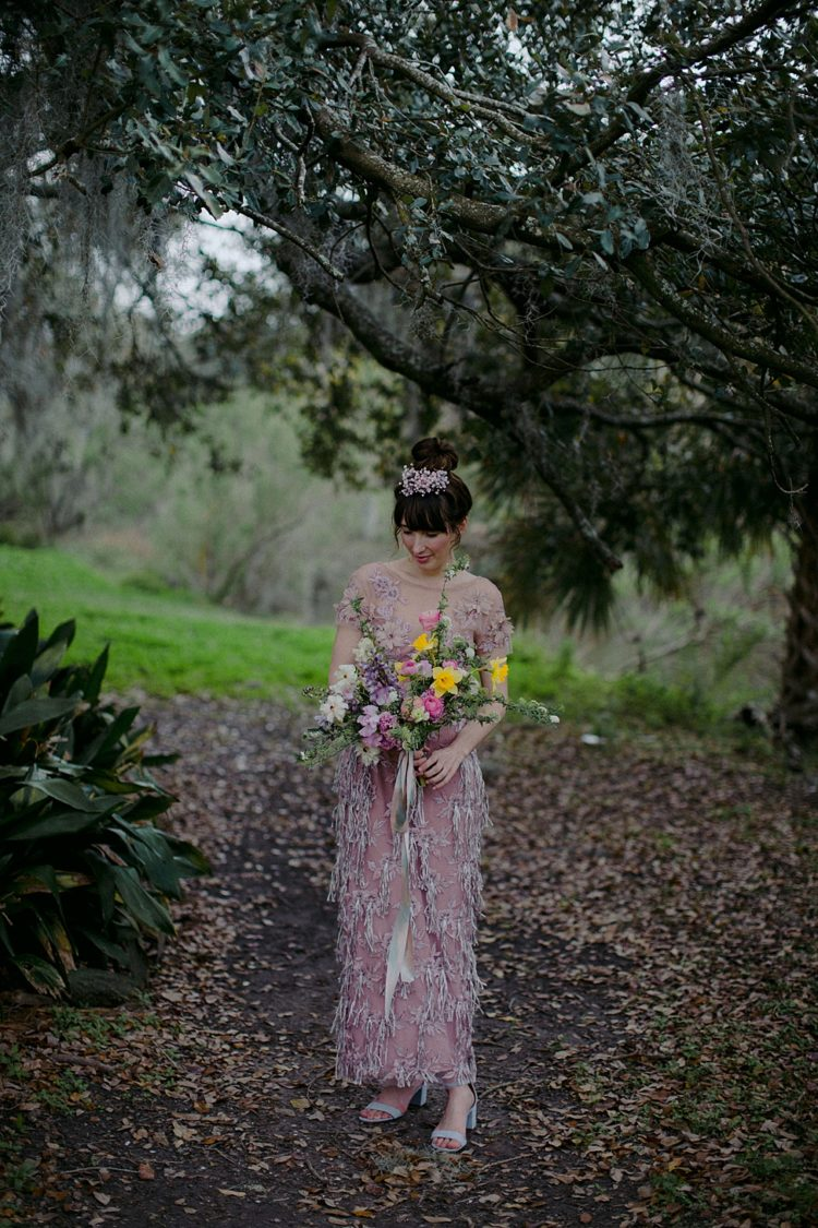 The bride was wearign a mauve beaded and applique sheath wedding dress and blue shoes
