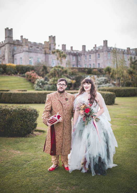 The bride was wearing a unique fairytale inspired wedding dress and cloak created for her, and the groom was wearing a traditional sherwani