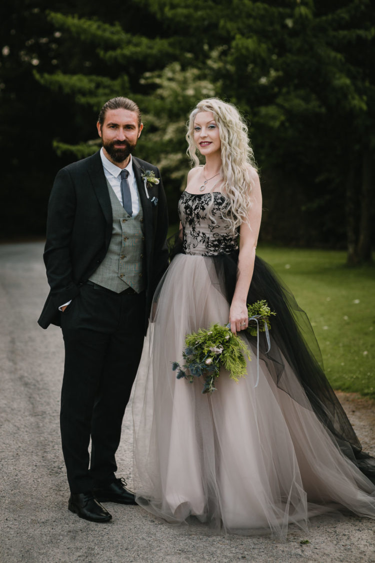 The bride was wearing a fantastic strapless A-line black and white wedding dress with a lace bodice, and the groom was wearing a black suit, a grey waistcoat and a grey tie