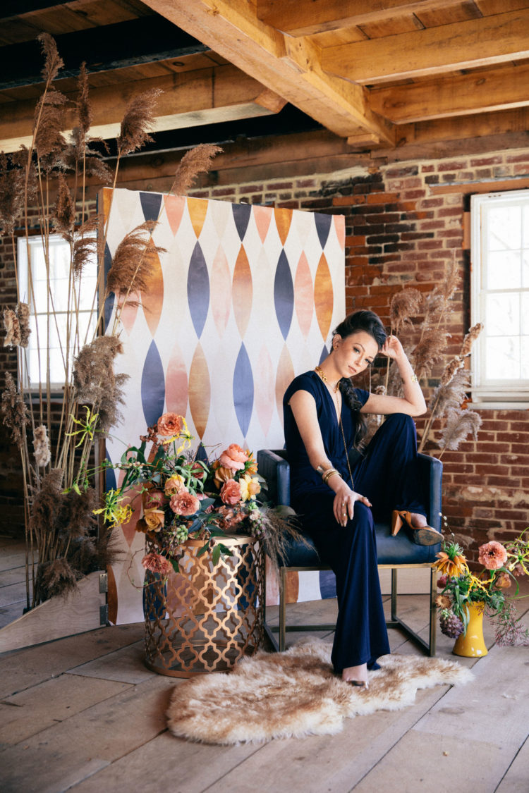 The first bridal look was done with a bright blue velvet jumpsuit with wideleg pants, a plunging neckline and a long necklace