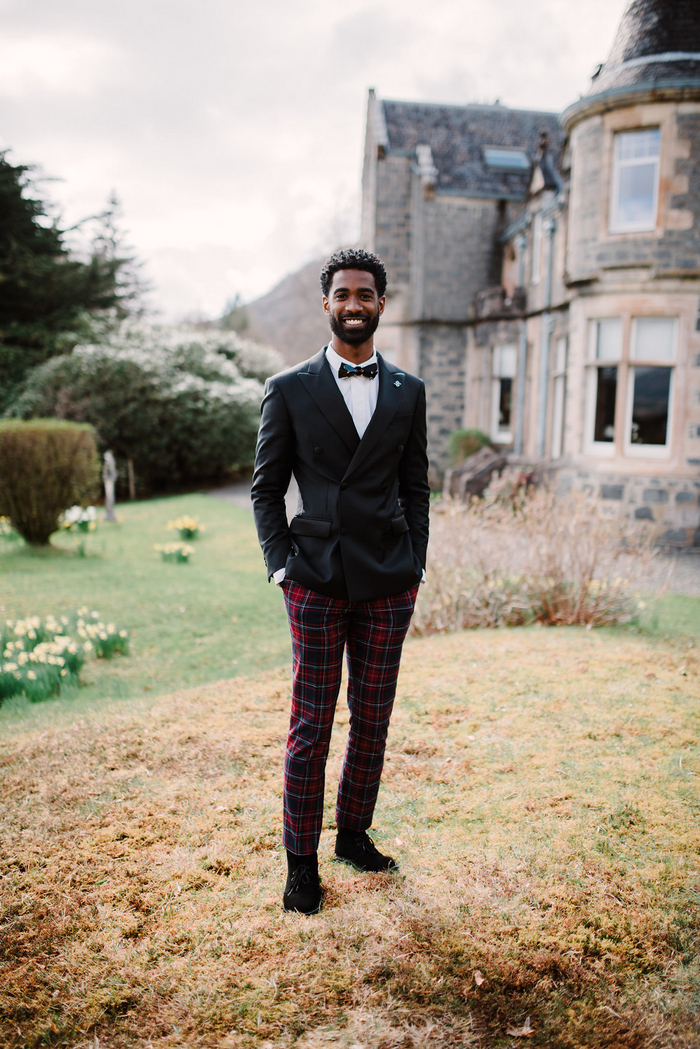 The groom was rocking a super chic look with plaid pants, a white shirt, a black jacket and black boots