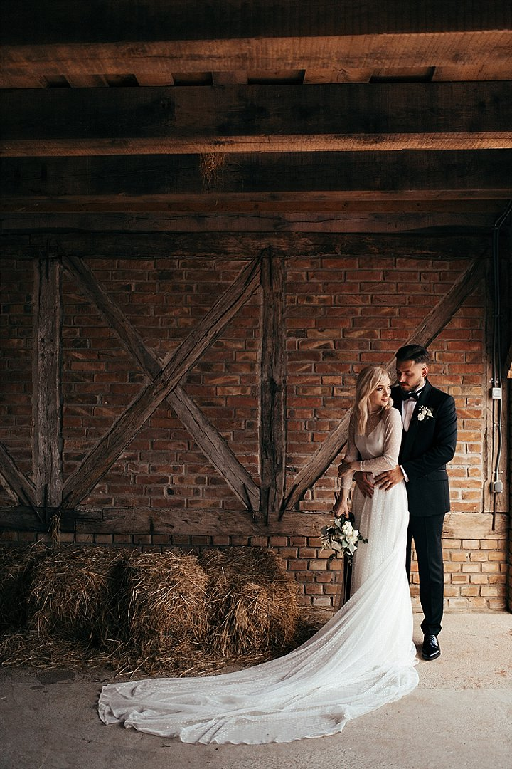 The groom was wearing a classic black tux, and the bride went for a simple slip dress and a polka dot sheer one over it