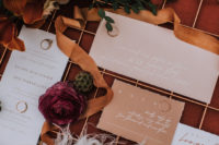 02 The wedding invitation suite was done in pastels, with a raw edge and copper calligraphy