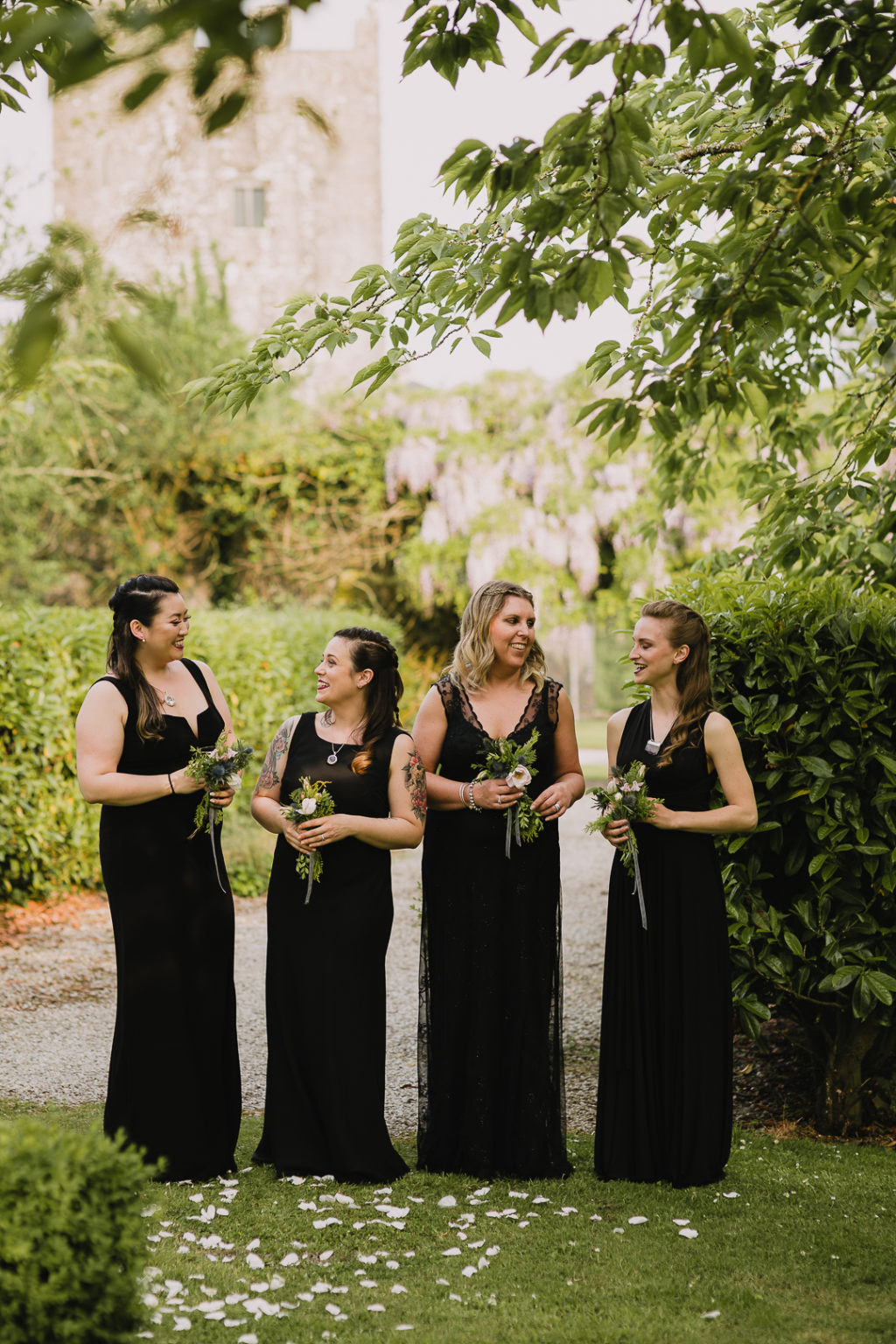 The bridesmaids were wearing mismatching black maxi dresses to match the gorgeous wedding gown