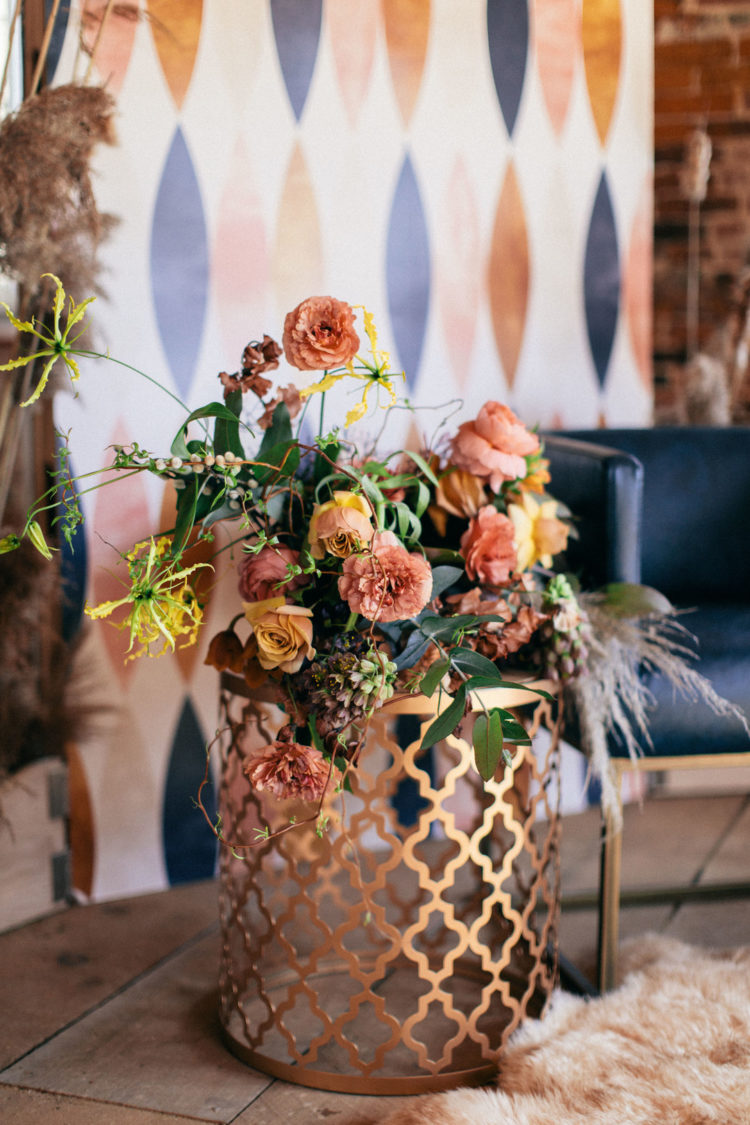 The wedding bouquet was a lush one, with muted-toned florals, greenery and bright yellow