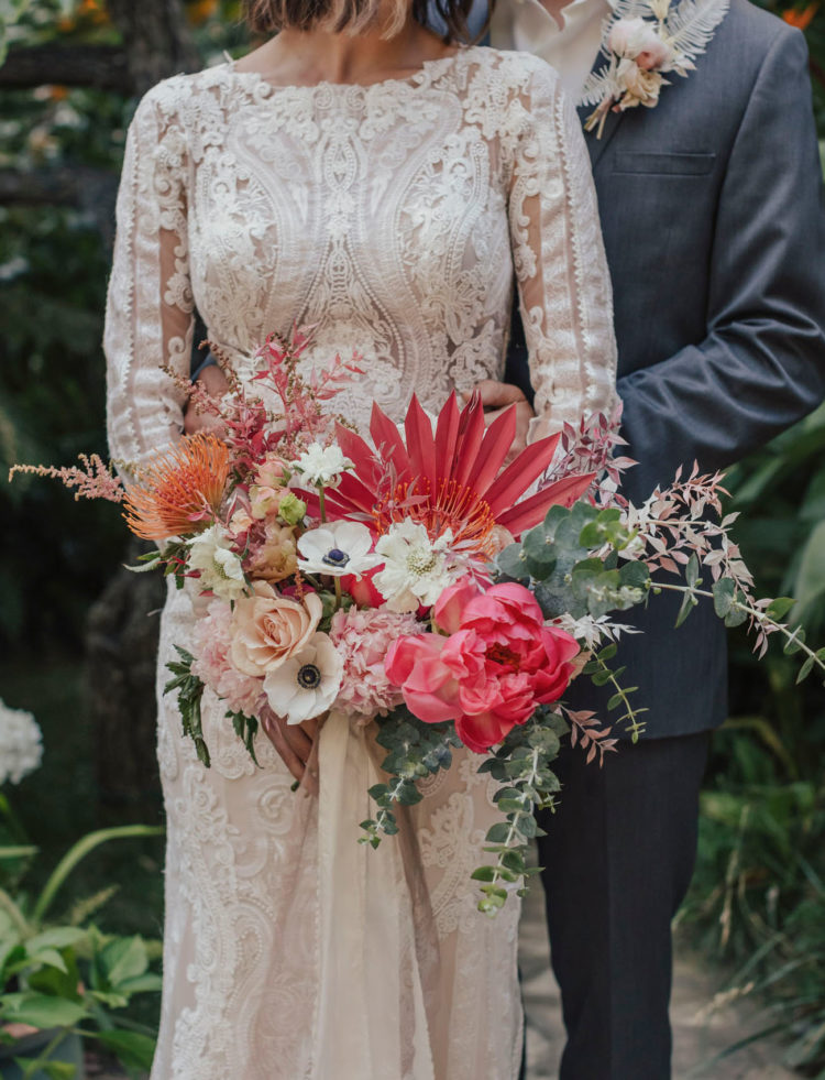 The wedding bouquet was bright pink, with blush and white blooms, dried flowers and eucalyptus
