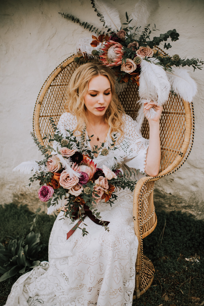 The bride was carrying a beautiful wedding bouquet with blush, dark and pink blooms and greenery